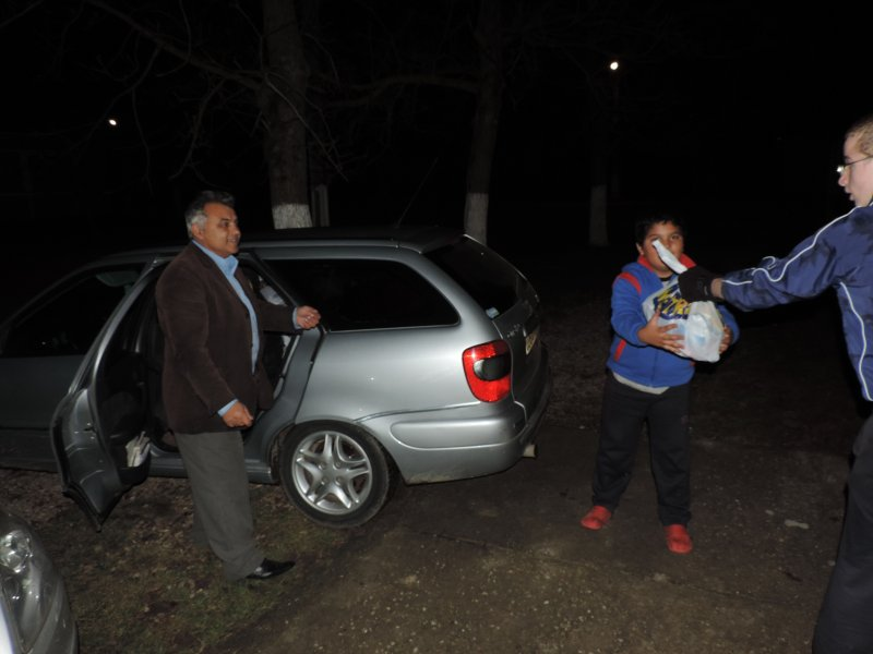 Pastor Marcel packing up his car