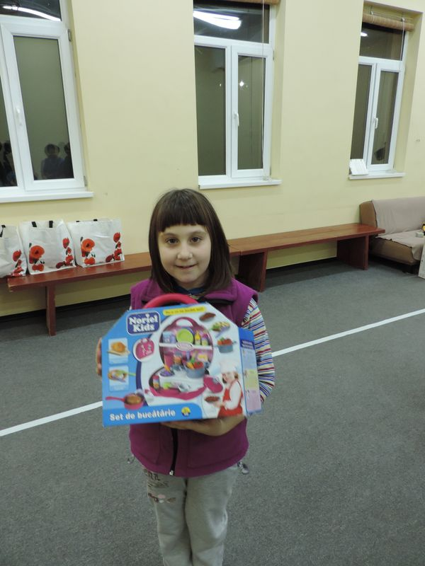Alexandra is ready to play house with her new kitchen set.JPG