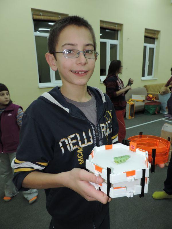 Razvan with one of his new toys.JPG