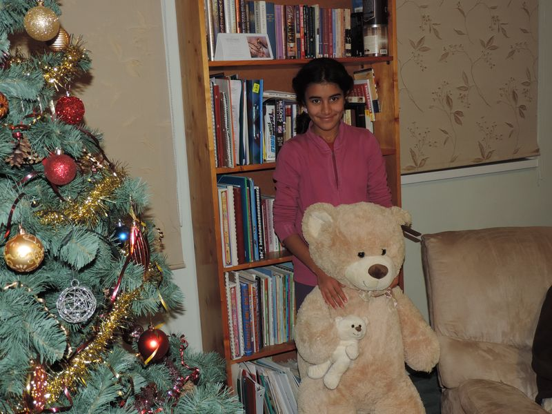 Bia and her new teddy bears.JPG