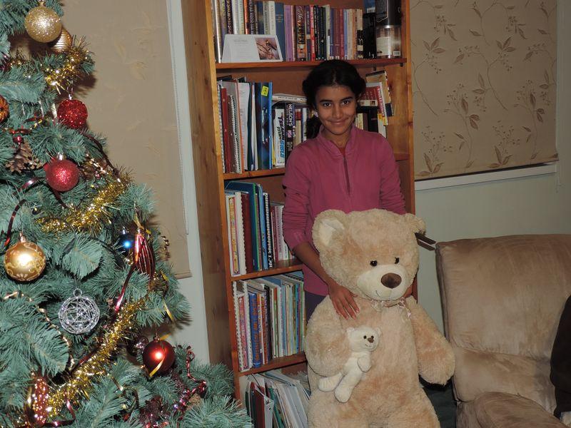 Bia and her new teddy bears.JPG