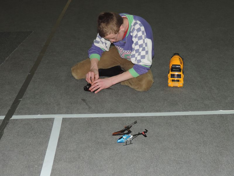 Cristi figuring out his remote control helicopter.JPG